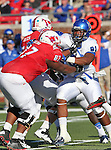 Southern Methodist Mustangs offensive linesman BRYAN COLLINS (67) and Memphis Tigers defensive lineman RICKY HUNTER (91) in action during the game between the Memphis Tigers and the Southern Methodist Mustangs at the Gerald J. Ford Stadium in Dallas, Texas. Memphis defeats SMU 48 to 3...