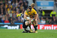 Matt Giteau of Australia looks to offload as he is tackled by Richie Gray and Dave Denton of Scotland during the Quarter Final of the Rugby World Cup 2015 between Australia and Scotland - 18/10/2015 - Twickenham Stadium, London<br /> Mandatory Credit: Rob Munro/Stewart Communications