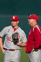 Oklahoma Sooners starting pitcher Jonathan Gray #22 talks with pitching coach John Giese before the NCAA baseball game against the Texas Longhorns on April 5, 2013 at UFCU DischFalk Field in Austin Texas. Oklahoma defeated Texas 2-1. (Andrew Woolley/Four Seam Images).