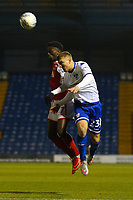 Fleetwood Town's Jordy Hiwula (left) battles with Bury's Joe Skarz (right) during the The Checkatrade Trophy match between Bury and Fleetwood Town at Gigg Lane, Bury, England on 9 January 2018. Photo by Juel Miah/PRiME Media Images.