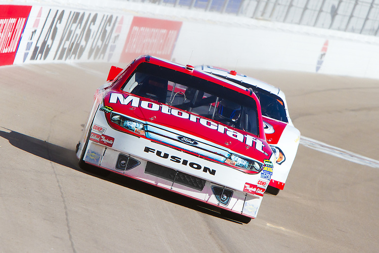 Feb. 3, 2012: Stock cars from Dale Jarrett Racing Adventure head toward turn one at Las Vegas Motor Speedway.