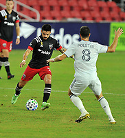 WASHINGTON, DC - SEPTEMBER 27: Junior Moreno #5 of D.C. United battles for the ball with Matt Polster #8 of New England Revolution during a game between New England Revolution and D.C. United at Audi Field on September 27, 2020 in Washington, DC.