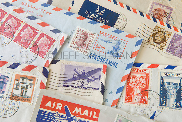 Old Air Mail Envelopes with Cancelled Postage Stamps from around the World<br /> <br /> AVAILABLE FOR COMMERCIAL OR EDITORIAL LICENSING FROM PLAINPICTURE.COM.  Please go to www.plainpicture.com and search for image # p569m791795