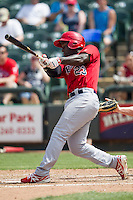 Memphis Redbirds second baseman Jermaine Curtis #23 swings the bat during the Pacific Coast League baseball game against the Round Rock Express on April 27, 2014 at the Dell Diamond in Round Rock, Texas. The Express defeated the Redbirds 6-2. (Andrew Woolley/Four Seam Images)