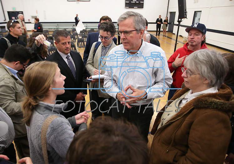 Former Florida Gov. Jeb Bush talks with University of Nevada, Reno student Ivy Ziedrich following a town hall meeting in Reno, Nev., on Wednesday, May 13, 2015.   <br /> Photo by Cathleen Allison