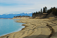 Lake Koocanusa lake bed exposed in early spring as the drained lake awaits spring runoff from the Kootenays.