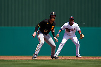 Pittsburgh Pirates Colin Moran (19) leads off second base in front of shortstop Jorge Polanco (11) during a Major League Spring Training game against the Minnesota Twins on March 16, 2021 at Hammond Stadium in Fort Myers, Florida.  (Mike Janes/Four Seam Images)