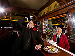 Actor Randy Quaid clowns around with bartender Manny Aguirre at Musso & Frank's Grill in Hollywood, California for Draft Magazine on July 6, 2007