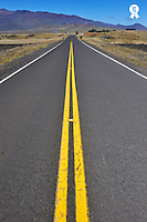 Dividing Line on Highway to Mauna Kea Volcano (Licence this image exclusively with Getty: http://www.gettyimages.com/detail/94433104 )