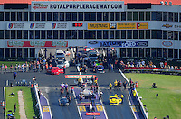 Apr. 28, 2012; Baytown, TX, USA: Aerial view of NHRA crew members for pro mod driver Leah Pruett (left) alongside Troy Coughlin during qualifying for the Spring Nationals at Royal Purple Raceway. Mandatory Credit: Mark J. Rebilas-