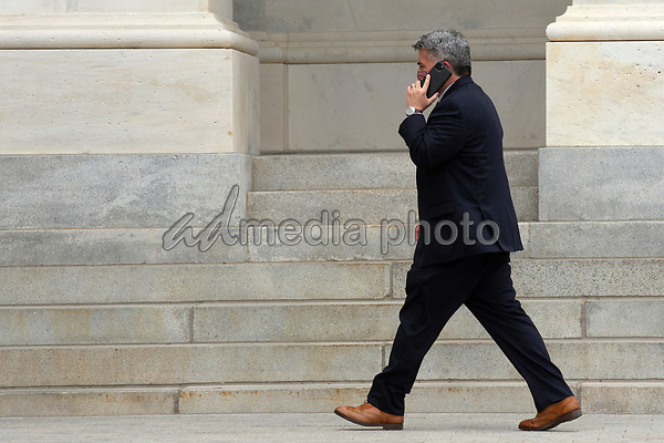 United States Senator Cory Gardner (Republican of Colorado) speaks on the phone as he leaves the United States Capitol in Washington D.C., U.S. on Thursday, May 21, 2020. Credit: Stefani Reynolds / CNP/AdMedia
