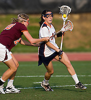 Julie Gardner (24) of Virginia tries to get past Joanna Kiser (20) of Virginia Tech during the first round of the ACC Women's Lacrosse Championship in College Park, MD.  Virginia defeated Virginia Tech, 18-6.