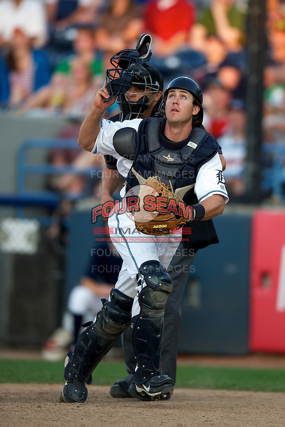 West Michigan Whitecaps Zach Maggard #27 looks for a pop up foul ball in front of umpire Fernando Rodriguez during a game against the Bowling Green Hot Rods at Fifth Third Ballpark on June 26, 2012 in Comstock Park, Michigan.  West Michigan defeated Bowling Green 13-11.  (Mike Janes/Four Seam Images)