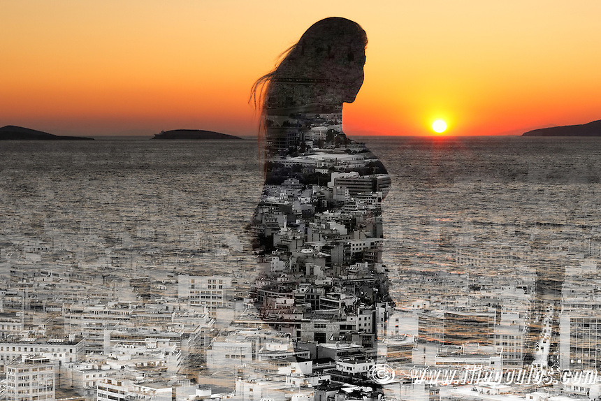 A city within the silhouette of a woman at sunset