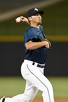 Pitcher Taylor Henry (17) of the Columbia Fireflies delivers a pitch in a game against the Charleston RiverDogs on Monday, August 7, 2017, at Spirit Communications Park in Columbia, South Carolina. Columbia won, 6-4. (Tom Priddy/Four Seam Images)