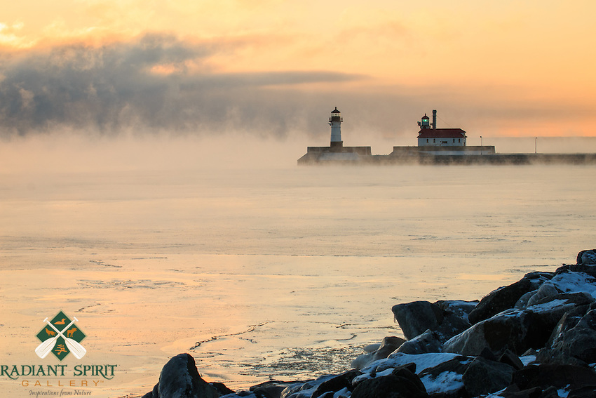 """""""Sea Smoke at Sunrise""""<br /> As the lake was making ice, her breath could be seen in the subzero air. The sea smoke is caused by evaporative cooling -- the cold air temperature and warmer open water of Lake Superior create this beautiful type of winter fog. Duluth winters are strikingly beautiful! On this particular morning, the air temperature was about 15 below zero Fahrenheit."""