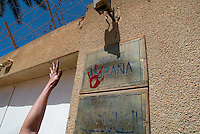 """Baghdad, Iraq, March 28, 2003.A Spanish """"Brigadist for Peace"""" stamps hands imprintswith red paint on the door of the Spanish embassy in Baghdad to protest against the Spanish involvement in the war against Iraq."""