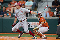 Oklahoma Sooners third baseman Garrett Carey #10 follows through on his swing against the Texas Longhorns in the NCAA baseball game on April 5, 2013 at UFCU DischFalk Field in Austin Texas. Oklahoma defeated Texas 2-1. (Andrew Woolley/Four Seam Images).