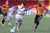 Takehiro Tomiyasu of Bologna FC and Bryan Dabo of SC Benevento compete for the ball<br /> during the Serie A football match between SC Benevento and Bologna FC at stadio Ciro Vigorito in Benevento (Italy), October 04th, 2020. <br /> Photo Cesare Purini / Insidefoto