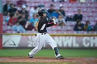 Salem-Keizer Volcanoes shortstop Nico Giarratano (6) follows through on his swing during a Northwest League game against the Eugene Emeralds at Volcanoes Stadium on August 31, 2018 in Keizer, Oregon. The Eugene Emeralds defeated the Salem-Keizer Volcanoes by a score of 7-3. (Zachary Lucy/Four Seam Images)
