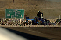 Apr 8, 2006; Las Vegas, NV, USA; NHRA Top Alcohol Funny Car driver Cy Chesterman jumps out of his car after his parachutes failed to deployed and he crashed into the catch net at the SummitRacing.com Nationals at Las Vegas Motor Speedway in Las Vegas, NV. Chesterman was unhurt in the incident. Mandatory Credit: Mark J. Rebilas