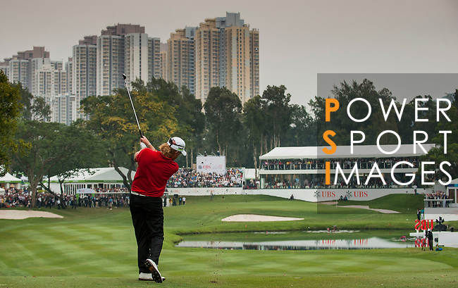 Miguel Angel Jimenez of Spain plays his second shot of the 18th hole during day four of the UBS Hong Kong Open Championship at the Hong Kong Golf Club on 18 November 2012, in Fanling. Photo by Victor Fraile / The Power of Sport Images