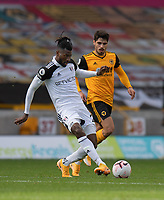 Fulham's Andre-Frank Zambo Anguissa (left) under pressure from Wolverhampton Wanderers' Pedro Neto (right) <br /> <br /> Photographer David Horton/CameraSport<br /> <br /> The Premier League - Wolverhampton Wanderers v Fulham - Sunday 4th October 2020 - Molineux Stadium - Wolverhampton<br /> <br /> World Copyright © 2020 CameraSport. All rights reserved. 43 Linden Ave. Countesthorpe. Leicester. England. LE8 5PG - Tel: +44 (0) 116 277 4147 - admin@camerasport.com - www.camerasport.com