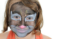 Girl (10)  with catlike painted face, portrait