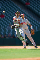 Houston Cougars shortstop Jose Reyes (12) makes a throw to first base against the Texas Tech Red Raiders at Minute Maid Park on February 26, 2016 in Houston, Texas.  The Red Raiders defeated the Cougars 3-2 in game one of the 2016 Shriners Hospitals for Children College Classic.  (Brian Westerholt/Four Seam Images)