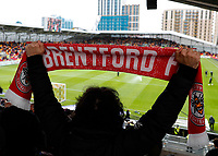 22nd May 2021; Brentford Community Stadium, London, England; English Football League Championship Football, Playoff, Brentford FC versus Bournemouth; Brentford fan holding up match scarf