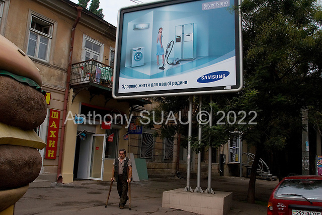 Odessa, Ukraine.August 26, 2005 ..Advertising, one of many illustrating the Ukrainian way of life and the woman's place in it.
