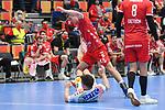 Ludwigshafens Max Neuhaus (Nr.37) gegen Magdeburgs Christoph Steinert (Nr.8)  beim Spiel in der Handball Bundesliga, Die Eulen Ludwigshafen - SC Magdeburg.<br /> <br /> Foto © PIX-Sportfotos *** Foto ist honorarpflichtig! *** Auf Anfrage in hoeherer Qualitaet/Aufloesung. Belegexemplar erbeten. Veroeffentlichung ausschliesslich fuer journalistisch-publizistische Zwecke. For editorial use only.