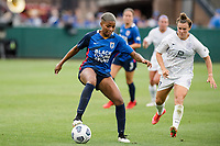TACOMA, WA - JULY 31: Tziarra King #23 of the OL Reign dribbles the ball during a game between Racing Louisville FC and OL Reign at Cheney Stadium on July 31, 2021 in Tacoma, Washington.