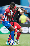 Thomas Teye Partey (L) of Atletico de Madrid fights for the ball with Iker Muniain Goni (R) of Athletic Club during their La Liga match between Atletico de Madrid vs Athletic de Bilbao at the Estadio Vicente Calderon on 21 May 2017 in Madrid, Spain. Photo by Diego Gonzalez Souto / Power Sport Images