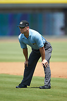 Umpire Jason Johnson handles the calls on the bases during the Carolina League game between the Potomac Nationals and the Winston-Salem Rayados at BB&T Ballpark on August 12, 2018 in Winston-Salem, North Carolina. The Rayados defeated the Nationals 6-3. (Brian Westerholt/Four Seam Images)