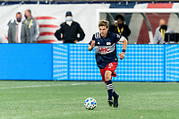 FOXBOROUGH, MA - OCTOBER 7: Scott Caldwell #6 of New England Revolution dribbles at midfield during a game between Toronto FC and New England Revolution at Gillette Stadium on October 7, 2020 in Foxborough, Massachusetts.