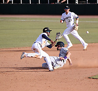 Lucius Fox, fielding the throw, of the Peoria Javelinas plays in the 2018 Arizona Fall League championship game won by the Peoria Javelinas, 3-2 in 10 innings, over the Salt River Rafters at Scottsdale Stadium on November 17, 2018 in Scottsdale, Arizona (Bill Mitchell)