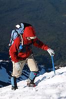 Man in red jacket climbing up snow on Mount Adams, Yakima County, Cascade  Mountains, Washington, USA