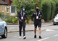 Brentford's Josh DaSilva and David Raya arrive at the ground ahead of kick-off wearing their face masks during Brentford vs Wigan Athletic, Sky Bet EFL Championship Football at Griffin Park on 4th July 2020