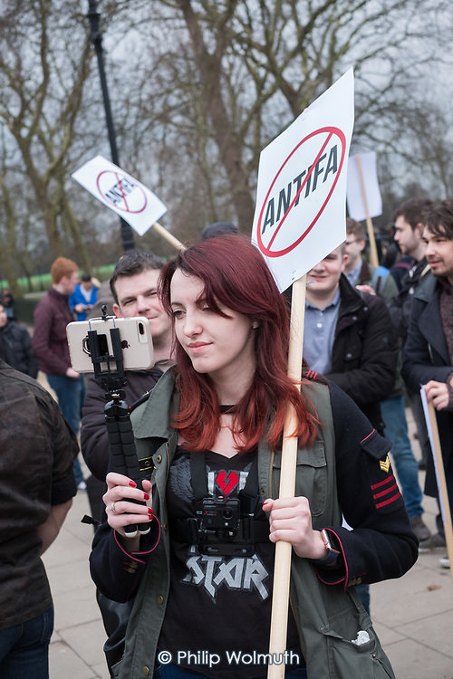 A supporter of detained Austrian far-right leader Martin Sellner videos a protest at Speakers' Corner, London, where he had been scheduled to speak.