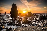 Sunset over rock formations near Rapahoe near Greymouth, West Coast, Buller Region,  New Zealand