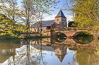 France, Correze, Vezere Valley, Saint Viance, bridge over Vezere river and Saint Viance church dated 12th century // France, Corrèze (19), Vallée de la Vézère, Saint-Viance, le pont sur la Vézère et l'église Saint-Viance du XIIe siècle