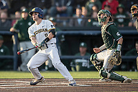 Michigan Wolverines shortstop Michael Brdar (9) follows through on his swing against the Michigan State Spartans during the NCAA baseball game on April 18, 2017 at Ray Fisher Stadium in Ann Arbor, Michigan. Michigan defeated Michigan State 12-4. (Andrew Woolley/Four Seam Images)