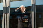 Pictured: 102 year old veteran Thomas Victor Hyom, who served in the Royal Navy pays his respects by saluting from the window of Wellington Vale Care Home, where he is a resident in Waterlooville, Hants ahead of Remembrance Day this Sunday. <br /> <br /> With the government implementing a month long nation-wide lockdown in order to curb the spread of the coronavirus pandemic, Remembrance Day parades have been cancelled across the country, with people urged to stay at home and pay their respects.<br /> <br /> © Jordan Pettitt/Solent News & Photo Agency<br /> UK +44 (0) 2380 458800