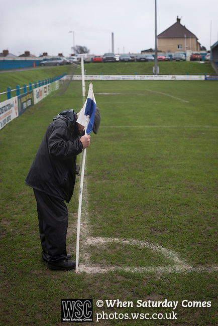Port Talbot Town 3 Caerau Ely 0, 06/02/2016. Genquip Stadium, Welsh Cup fourth round. A club official putting a corner flag into the pitch before Port Talbot Town played host to Caerau Ely in a Welsh Cup fourth round tie at the Genquip Stadium, formerly known as Victoria Road. Formed by exiled Scots in 1901 as Port Talbot Athletic, they competed in local and regional football before being promoted to the League of Wales  in 2000 and changing their name to the current version a year later. Town won this tie 3-0 against their opponents from the Welsh League, one level below the welsh Premier League where Port Talbot competed, watched by a crowd of 113. Photo by Colin McPherson.