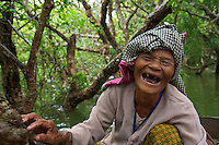 A very happy old lady on the Tonle Sap Lake Cambodia