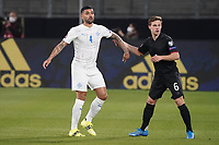 Victor Palsson (Island Iceland) gegen Joshua Kimmich (Deutschland Germany) - 25.03.2021: WM-Qualifikationsspiel Deutschland gegen Island, Schauinsland Arena Duisburg