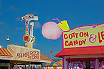 Fair food and midway rides bring thrills to fairgoers at The Puyalup Fair.  Western Washington State Fair.