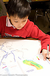 Elementary School Grade 3 geography boy working on map project