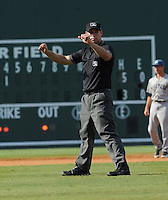 Umpire Tyler Curtis works a game between the Asheville Tourists and Greenville Drive on Sunday, August 26, 2012, at Fluor Field at the West End in Greenville, South Carolina. (Tom Priddy/Four Seam Images)